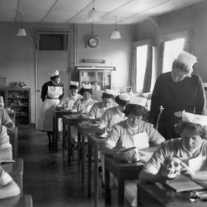 Nurses, black and white image, in classroom