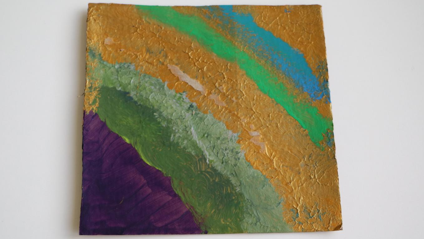 A painting with purple, green, gold and blue