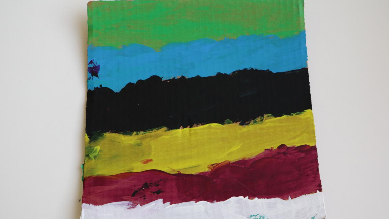 A painting with green, blue, black, yellow, red and white stripes